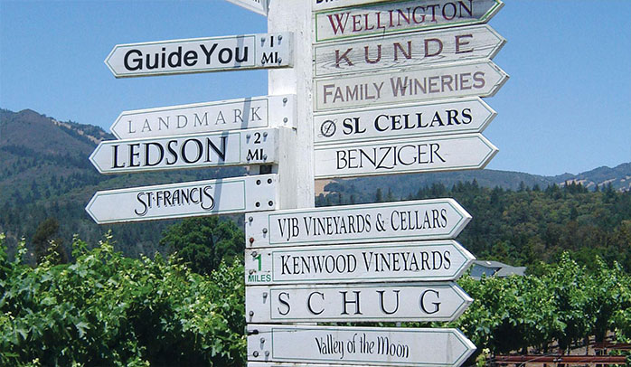 A street signing pointing the directions for various Sonoma Valley wineries